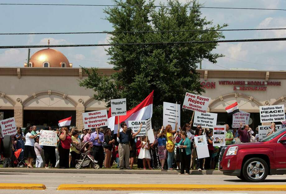 More than 300 Coptic Christians from Saint Mary & Archangel Michael Coptic Orthodox Church and other Coptic parishes gathered along FM 529 near Highway 6 to demonstrate in support of the Egyptian Army and democracy in Egypt Sunday, Aug. 18, 2013, in Houston. 