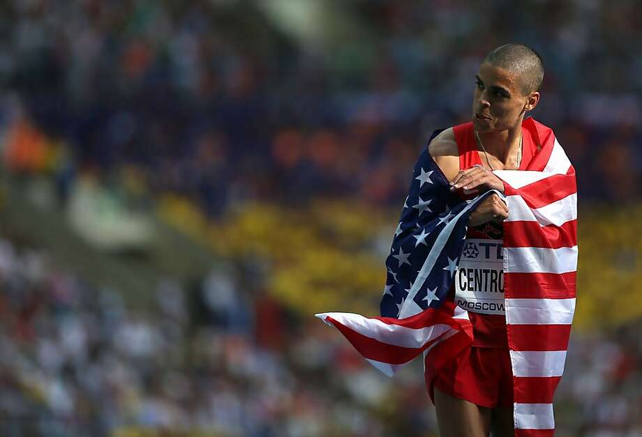 Matt Centrowitz wears the flag proudly in Moscow. Photo: Adrian Dennis, AFP/Getty Images