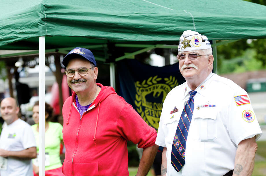 Dennis Salzer, USN Retired, who served from 1968-1997, of Shelton, stands alongside Air Force Veteran Frank Dlugokinski, who served from 1955-1963, of Litchfield, during the fourth annual Sunset Run for the Warriors at the Huntington Green in Shelton on Sunday, Aug. 18, 2013. Photo: Amy Mortensen / Connecticut Post Freelance