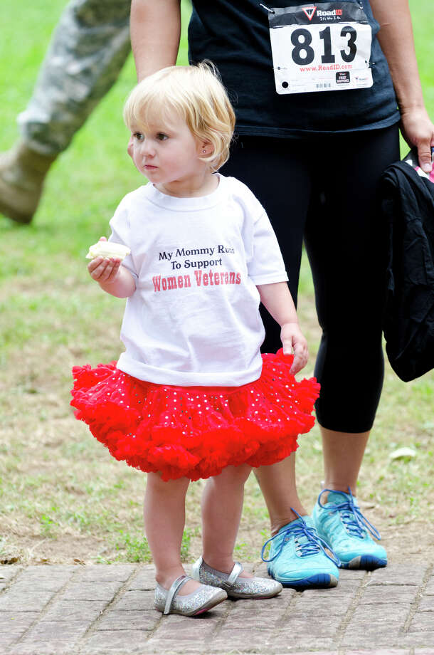 "Mary Mae Cust, 2, of Shelton, wears a shirt which reads ""My mommy runs to support women veterans"" during the fourth annual Sunset Run for the Warriors at the Huntington Green in Shelton on Sunday, Aug. 18, 2013. Cust's mother, Lauren, served in the Army Reserves from 2006-2011 and served in Iraq from 2008-2009. Photo: Amy Mortensen / Connecticut Post Freelance"