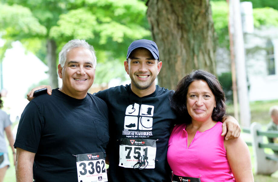 Army Veteran Albert Negron, 1976-1982, of Shelton, poses for a photo with his son, Ashton, and wife, Mary during the fourth annual Sunset Run for the Warriors at the Huntington Green in Shelton on Sunday, Aug. 18, 2013. Photo: Amy Mortensen / Connecticut Post Freelance