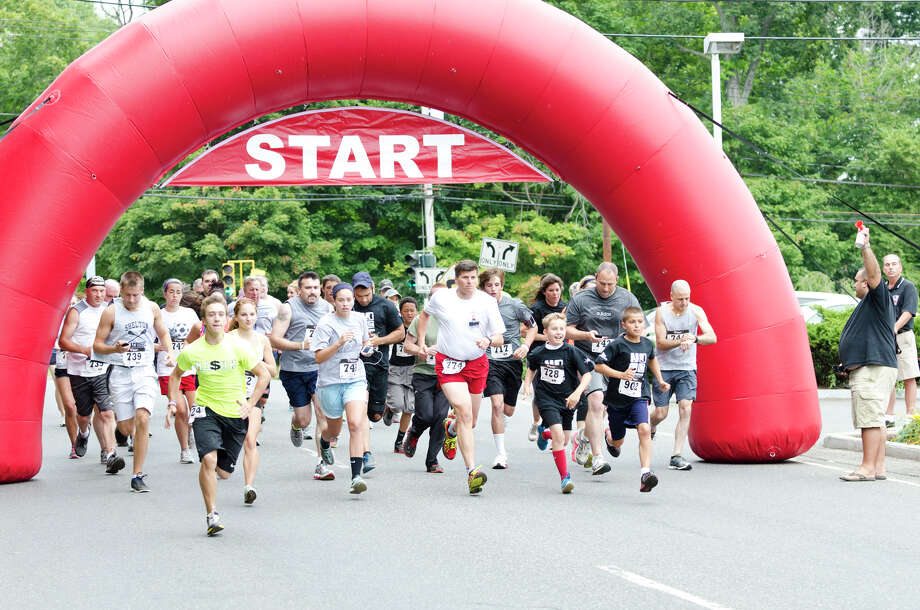 The fourth annual Sunset Run for the Warriors at the Huntington Green in Shelton on Sunday, Aug. 18, 2013. Photo: Amy Mortensen / Connecticut Post Freelance