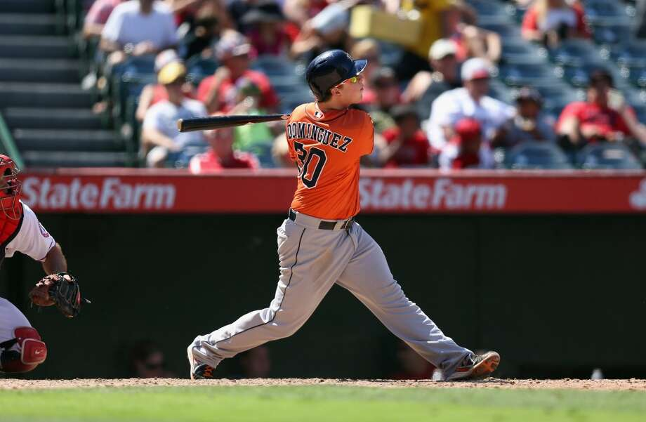 Aug. 18: Astros 7, Angels 5  Matt Dominguez of the Astros hits a 3-run home run against the Angels during the seventh inning. Photo: Jeff Gross, Getty Images
