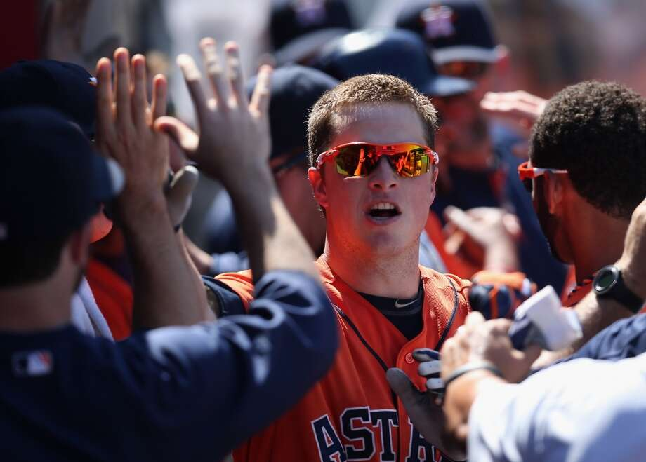 Matt Dominguez of the Astros is congratulated in the dugout after hitting a home run. Photo: Jeff Gross, Getty Images