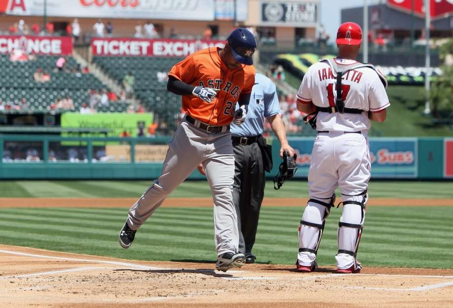 L.J. Hoes of the Astros reaches home plate after hitting a home run. Photo: Jeff Gross, Getty Images