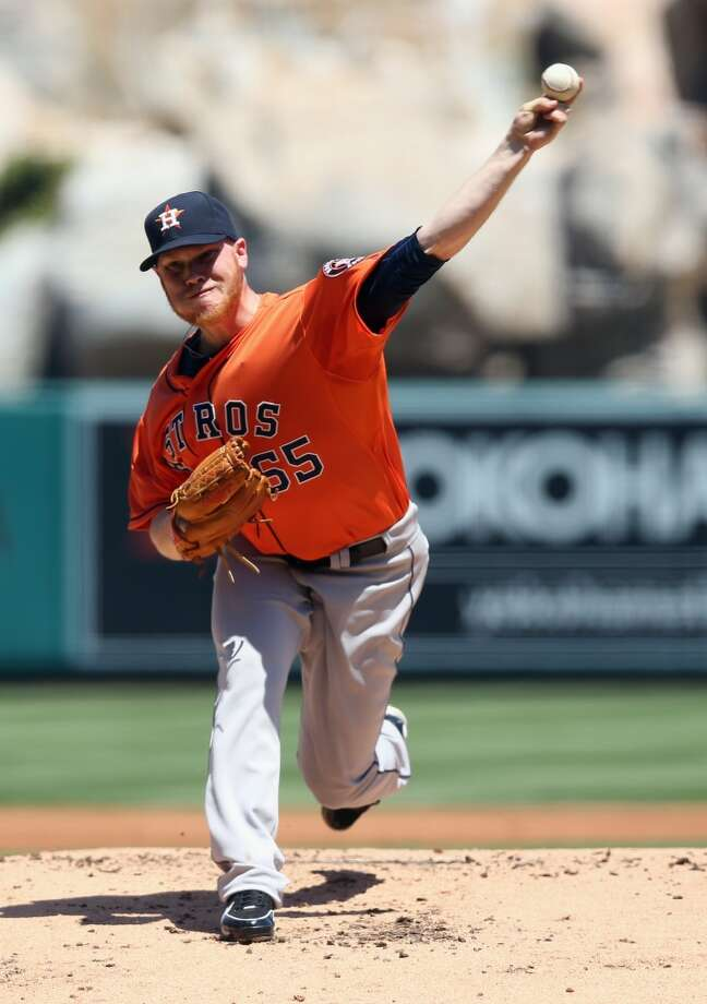 Astros pitcher Brett Oberholtzer delivers a throw to the Angels. Photo: Jeff Gross, Getty Images