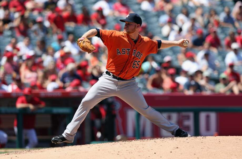 Astros pitcher Brett Oberholtzer makes a throw to the angels. Photo: Jeff Gross, Getty Images
