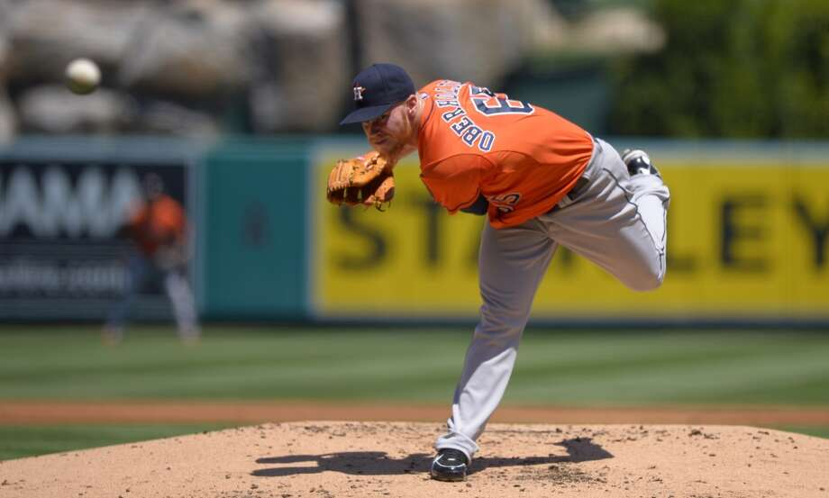 Astros pitcher Brett Oberholtzer delivers a throw to the Angels. Photo: Mark J. Terrill, Associated Press