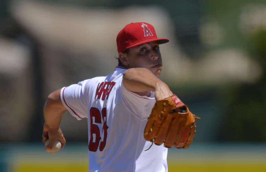 Angels pitcher Jason Vargas delivers a throw to the Astros. Photo: Mark J. Terrill, Associated Press