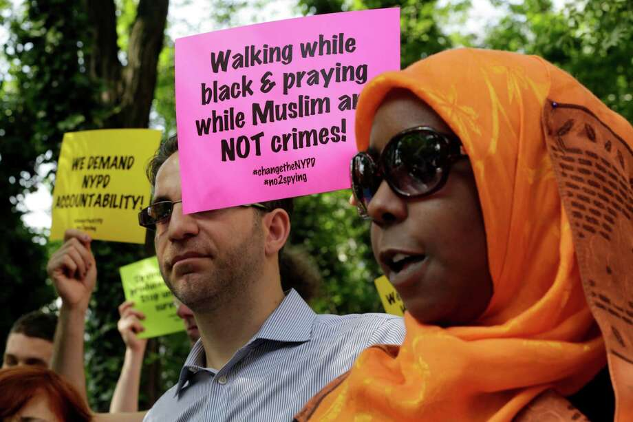 Earlier this year, supporters of a lawsuit challenging NYPD's Muslim surveillance program express their views outside NYPD's headquarters. Photo: Richard Drew, STF / AP