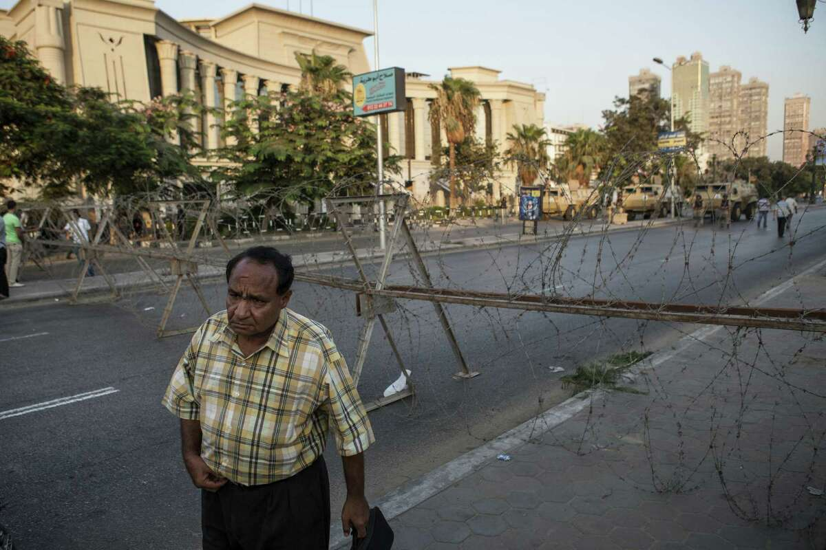 An Egyptian man stands in front of a military checkpoint at Cairo's Supreme Constitutional Court building, a destination point for marches in support of deposed president Mohammed Morsi.
