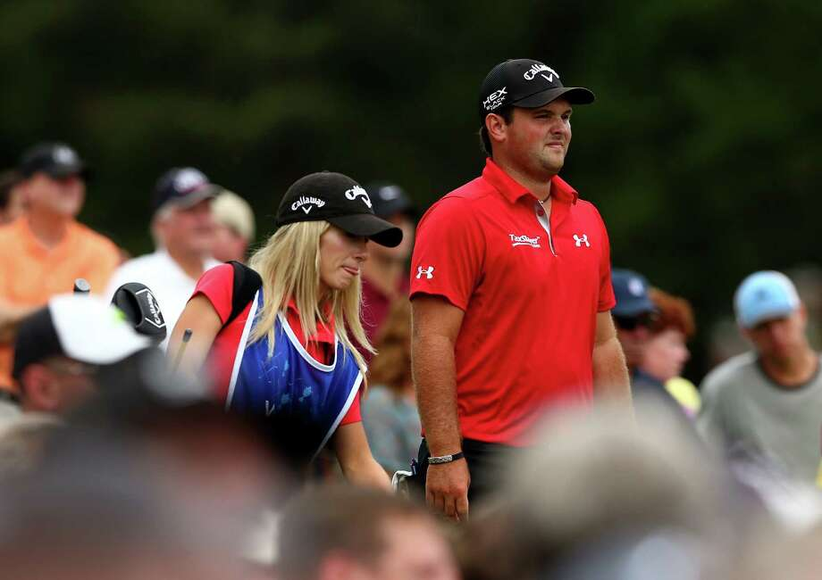 GREENSBORO, NC - AUGUST 18:  (L-R) Patrick Reed walks with his caddie and wife Justine Reed during the final round of the Wyndham Championship at Sedgefield Country Club on August 18, 2013 in Greensboro, North Carolina.  (Photo by Streeter Lecka/Getty Images) ORG XMIT: 159810070 Photo: Streeter Lecka / 2013 Getty Images