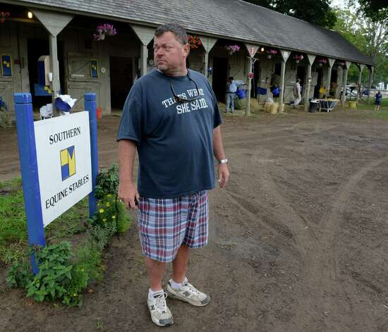 Trainer Eric Guillot surveys his barn area at the Oklahoma Training Center Aug 18, 2013 at the Saratoga Race Course in Saratoga Springs, N.Y.    (Skip Dickstein/Times Union) Photo: SKIP DICKSTEIN