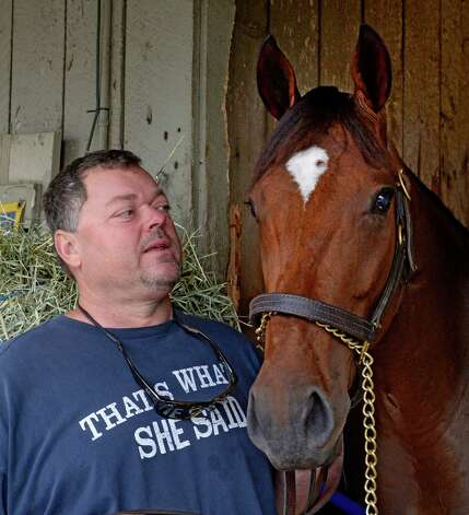 Trainer Eric Guillot stands with his Travers Stakes entrant Moreno at his barn area at the Oklahoma Training Center Aug 18, 2013 at the Saratoga Race Course in Saratoga Springs, N.Y.    (Skip Dickstein/Times Union) Photo: SKIP DICKSTEIN