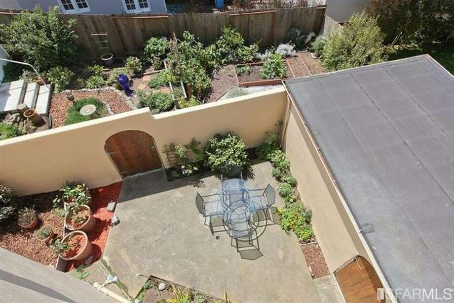 Peeking down into patio/yard.  SFMLS / Coldwell Banker Res. R.E. Svcs/Estately