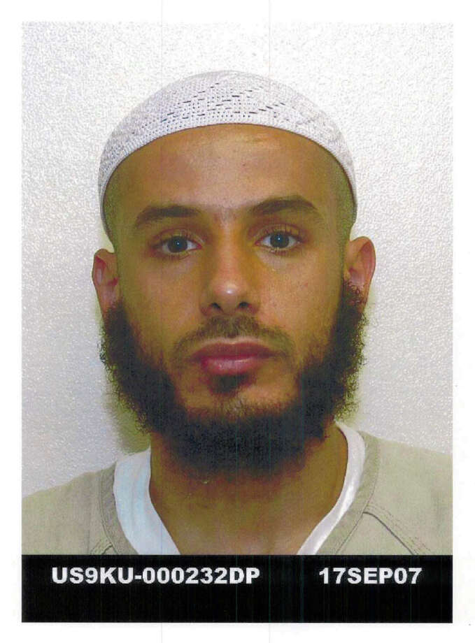 """This Sept. 17, 2007 photo released on Aug. 13, 2013 by defense lawyer U.S. Air Force Lt. Col. Barry Wingard, detainee Fawzi al-Odah, 36, is shown in Guantanamo Bay U.S. Naval Base. Fawzi al-Odah is a Kuwaiti who has been held for more than 11 years at the Guantanamo Bay prison. The Pentagon says the roughly 50 men in the indefinite detention category are held under international laws of war until the """"end of hostilities,"""" whenever that may be. As a group, they are one of the chief hurdles to President Barack Obama's attempts to close the detention center on the U.S. base in Cuba. (AP Photo/Courtesy of defense lawyer  Barry Wingard) Photo: HOPD / Defense lawyer U.S. Air Force Lt"""