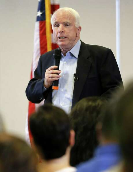 Sen. John McCain speaks at a town hall meeting in Tucson, Ariz., about the omnibus immigration bill. Photo: Matt York / Associated Press