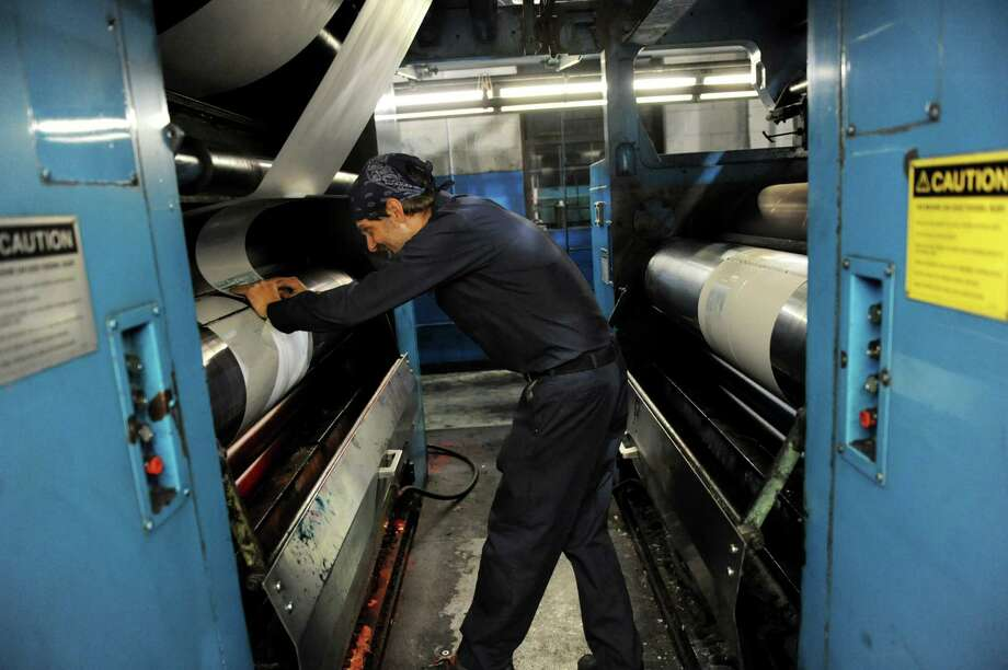 Pressman Mike Flora plates the Goss offset press for printing The Kingston Daily Freeman on Thursday, Aug. 15, 2013, at The Troy Record in Troy, N.Y. (Cindy Schultz / Times Union) Photo: Cindy Schultz / 00023553A