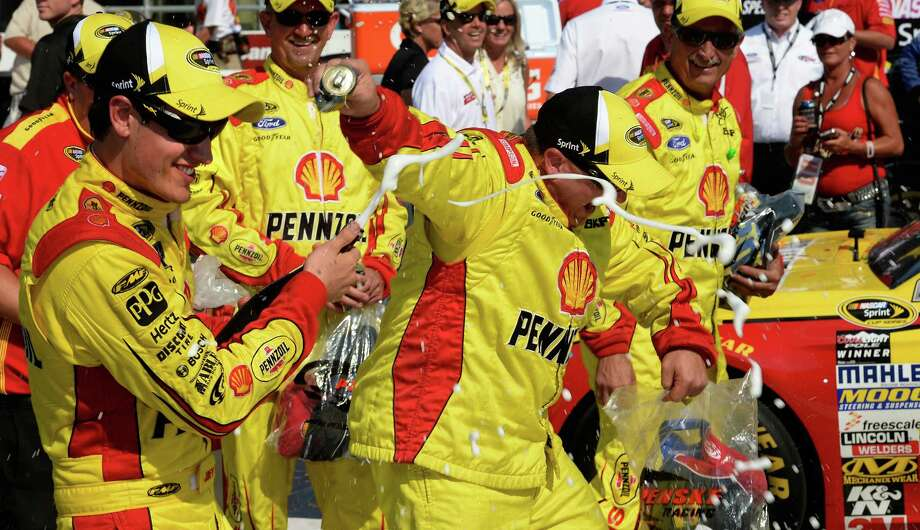 BROOKLYN, MI - AUGUST 18:  Joey Logano, driver of the #22 Shell-Pennzoil Ford, celebrates with champagne in Victory Lane after winning the NASCAR Sprint Cup Series 44th Annual Pure Michigan 400 at Michigan International Speedway on August 18, 2013 in Brooklyn, Michigan.  (Photo by John Harrelson/Getty Images) ORG XMIT: 159337374 Photo: John Harrelson / 2013 Getty Images