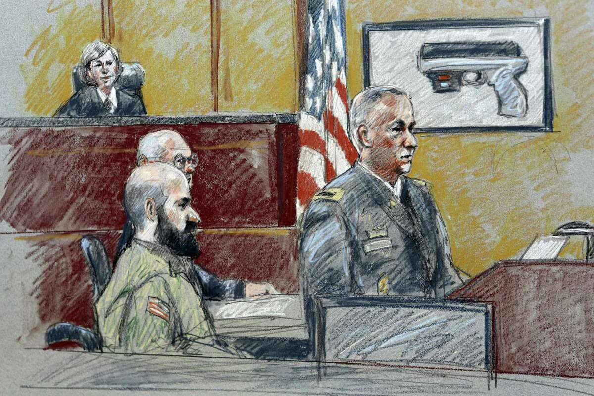 Col. Steve Henricks (right), shown at the trial of Maj. Nidal Hasan (left, with beard), credited Hasan's landlord with finding the officer's laptop and giving it to police.