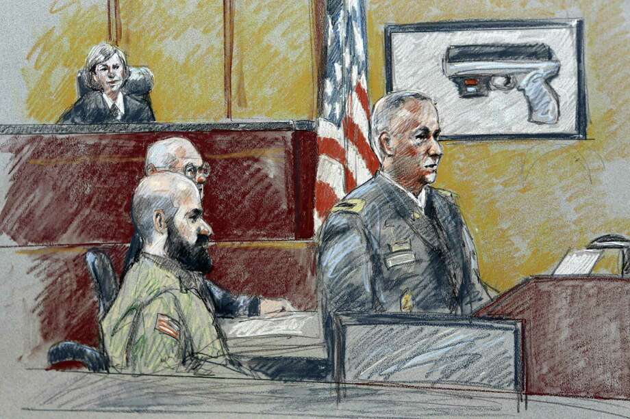 Col. Steve Henricks (right), shown at the trial of Maj. Nidal Hasan (left, with beard), credited Hasan's landlord with finding the officer's laptop and giving it to police. Photo: Associated Press