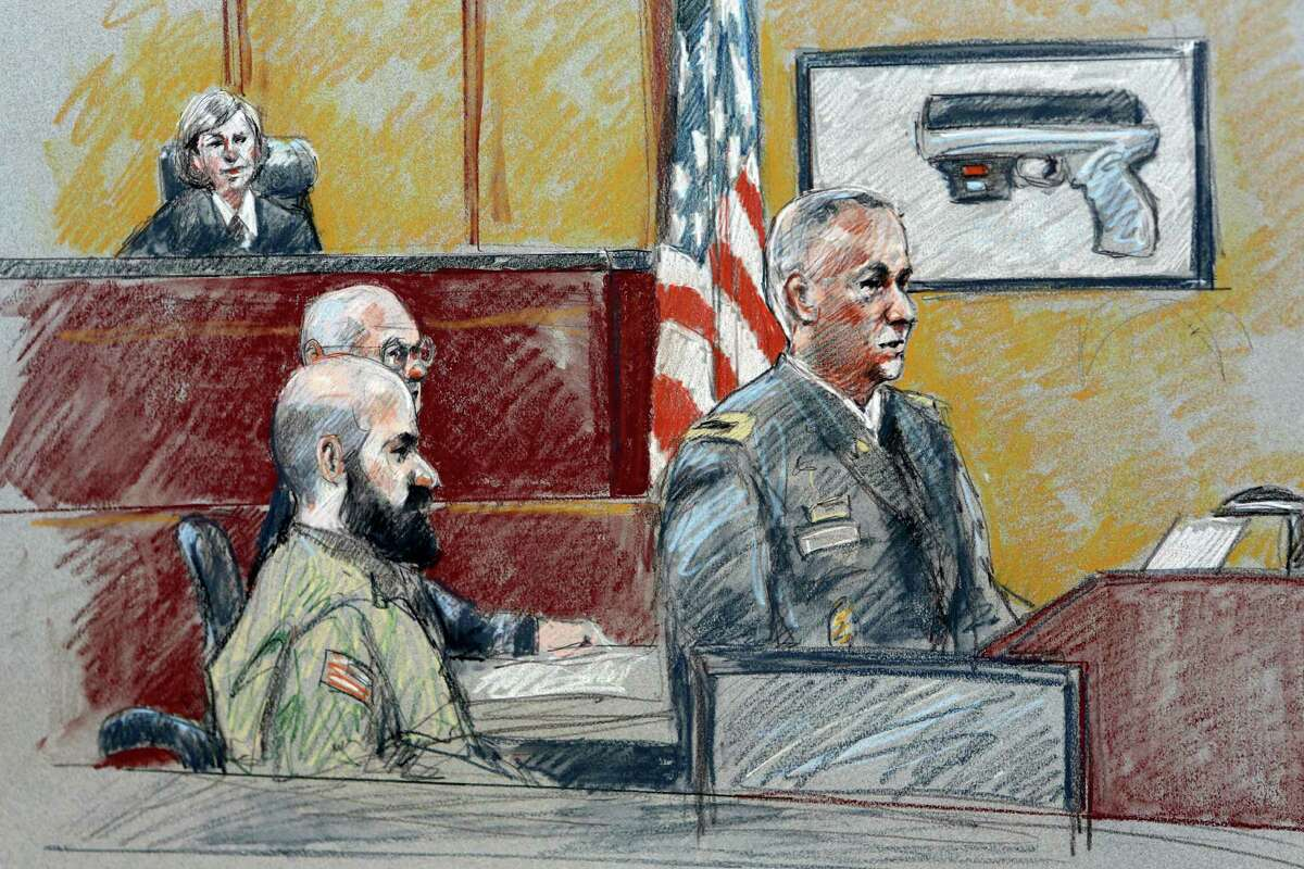 FILE - In this Aug. 6, 2013 file courtroom sketch, military prosecutor Col. Steve Henricks, right, speaks as Nidal Malik Hasan, center, and presiding judge Col. Tara Osborn look on during Hasan's court-martial in Forth Hood, Texas. FBI agent Donna Cowling, who searched the apartment of Hasan, testified Friday, Aug. 16, 2013, that it was nearly empty when she led a team to the home the night of the attack. Cowling says there was no furniture, only a card table, a prayer rug and a shredder. On the table was a package for a pistol laser sight, rubber bands and paper towels. (AP Photo/Brigitte Woosley, File)