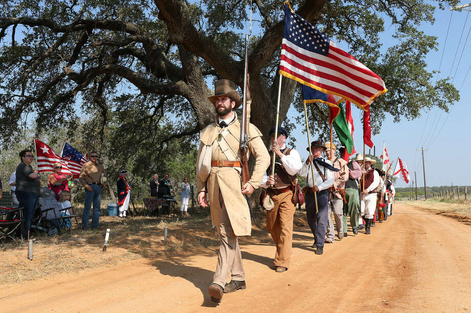 Re-enactors line up for a three-volley salute during the 200th anniversary of the Battle of Medina on Old Applewhite Road in Atascosa County. Photo: Photos By Jerry Lara / San Antonio Express-News