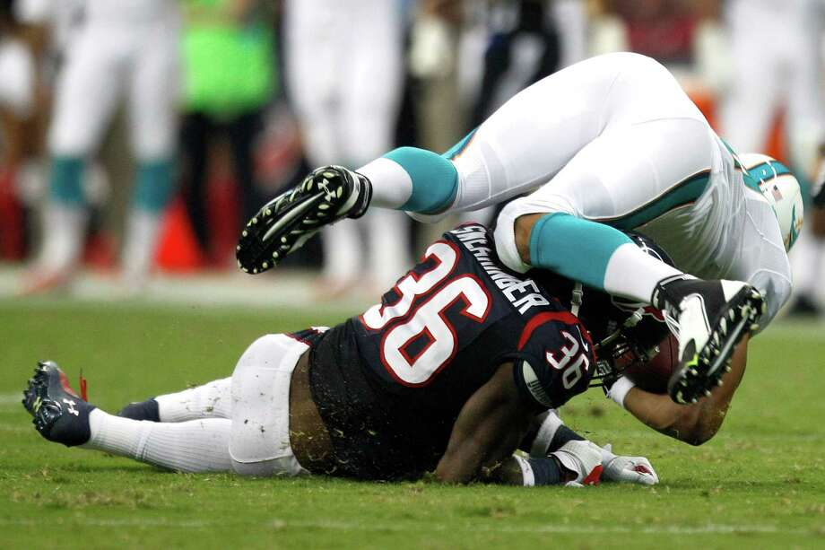 Miami tight end Dustin Keller suffered a season-ending injury to his right knee in Saturday night's exhibition game at Reliant Stadium when he was tackled by Texans rookie safety D.J. Swearinger in the second quarter. Photo: Brett Coomer, Staff / © 2013  Houston Chronicle