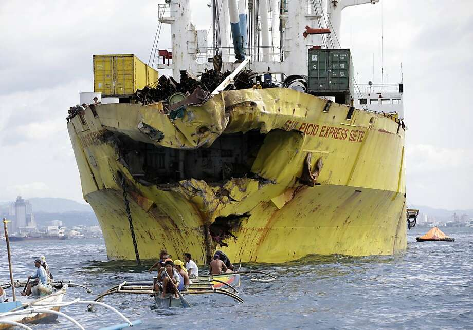 Volunteers search for survivorsnear the damaged cargo ship Sulpicio Express after it collided with   the ferry St. Thomas Aquinas the night before off Talisay, Philippines. At least 55 people were killed, and dozens are still missing after the crash, which occurred in almost total darkness. The Thomas Aquinas, with about 870 aboard, sunk quickly, but most passengers jumped overboard in time and were rescued. Photo: Bullit Marquez, Associated Press