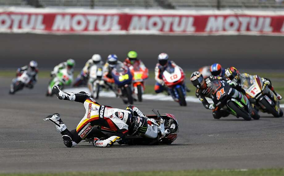 Australian Jack Miller wrecks during the Indianapolis Grand Prix Moto3 motorcycle race at the Indianapolis Motor Speedway Sunday, Aug. 18, 2013, in Indianapolis. (AP Photo/Darron Cummings) Photo: Darron Cummings, Associated Press
