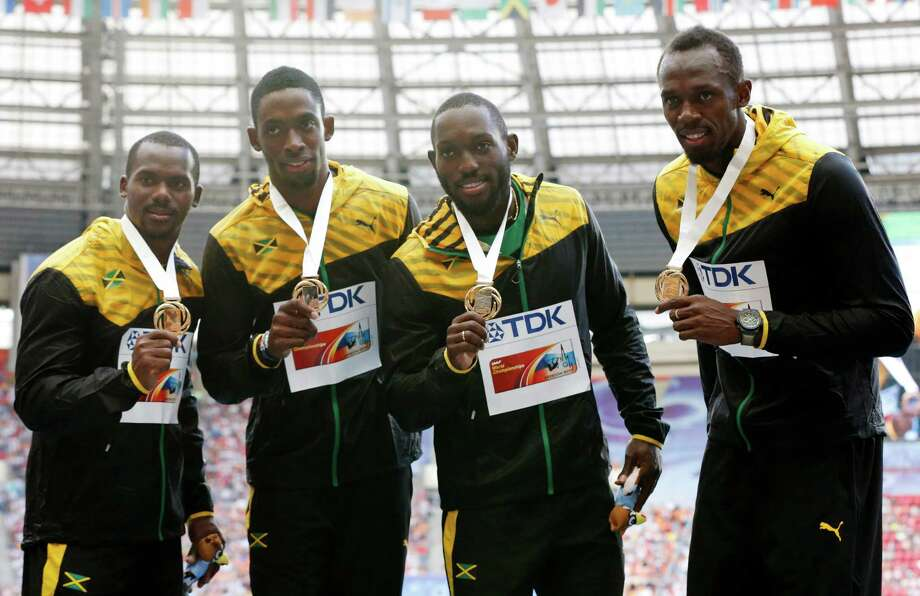 Usain Bolt was as good as gold again Sunday after helping Jamaica win the 400-meter relay at the world championships. Photo: Misha Japaridze, STR / AP