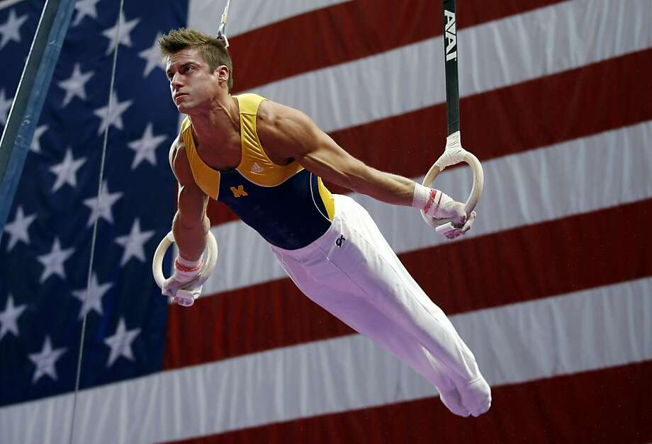 Sam Mikulak competes on the rings during the U.S. men's national gymnastics championships in Hartford, Conn., Sunday, Aug. 18, 2013. Mikulak won the U.S. men's gymnastic title. (AP Photo/Elise Amendola) Photo: Elise Amendola, Associated Press