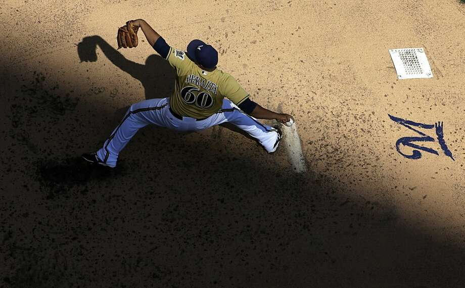 Milwaukee Brewers starting pitcher Wily Peralta throws during the fourth inning of an MLB National League baseball game against the Cincinnati Reds Sunday, Aug. 18, 2013, in Milwaukee. (AP Photo/Morry Gash) Photo: Morry Gash, Associated Press