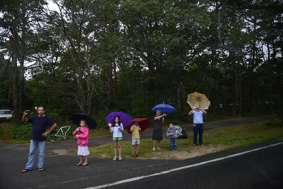 TISBURY, MA - AUGUST 18: (AFP OUT) People watch as the motorcade of President Barack Obama passes by on August 18, 2013 in Tisbury, Massachusetts. The Obama's are spending their last day on the island of Martha's Vineyard before returning to DC. (Photo by Darren McCollester/Getty Images) Photo: Darren McCollester, Getty Images