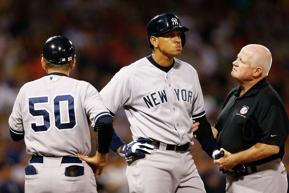 Alex Rodriguez receives attention after being hit by a pitch that sparked some second-inning drama. The Yankee earned his revenge against Red Sox starter Ryan Dempster with a home run in the sixth inning. Photo: Jared Wickerham, Staff / 2013 Getty Images