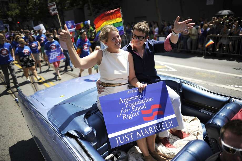 Cheer at a the Gay Pride parade or other big parades throughout the year. Photo: Michael Short, Special To The Chronicle