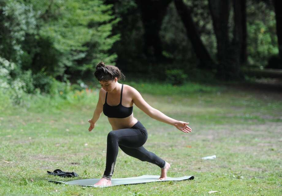 Center yourself at one of many free yoga classes throughout the city. One is offered by San Francisco Recreation and Parks at Golden Gate Park on Saturday mornings. Photo: Susana Bates, Special To The Chronicle