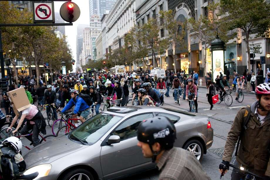 Liberate your inner anarchist-- ride in at least one Critical Mass. Photo: Jason Henry, Special To The Chronicle