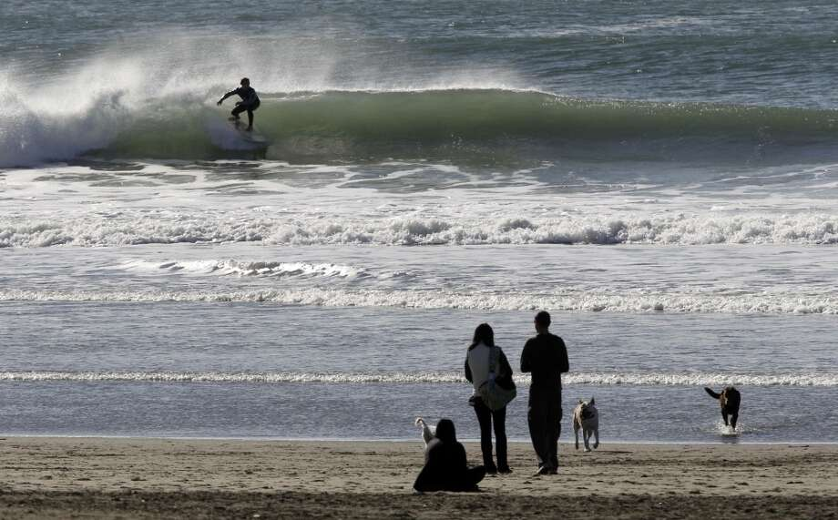 Watch the surfers at Ocean Beach. Photo: Michael Macor, The Chronicle