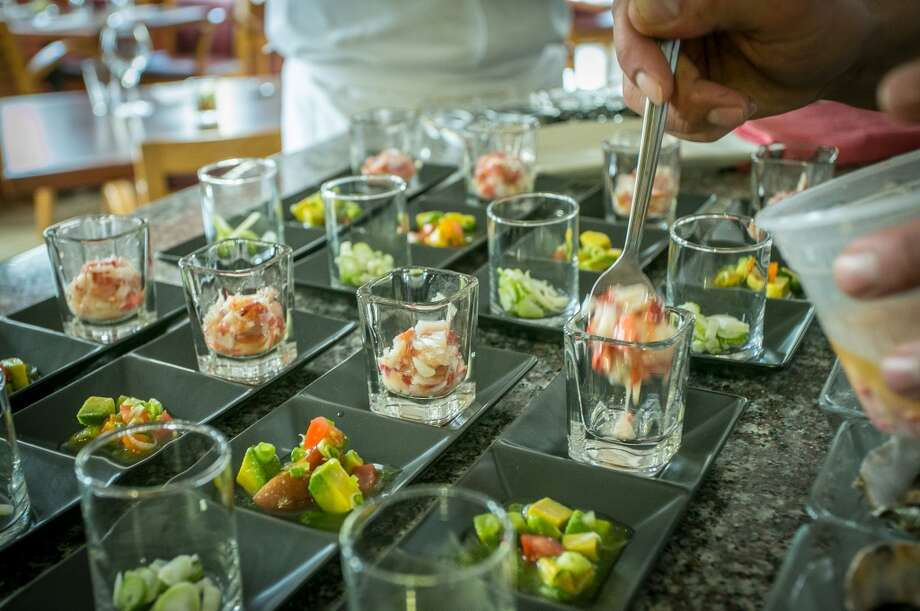 The Lobster Three Ways being plated at The Palace in San Francisco. Photo: John Storey, Special To The Chronicle