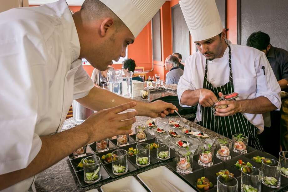 Chef Chef Manny Torres Gimenez and Samir Mogannam, right, plate Frutas del Mar at The Palace in San Francisco,. Photo: John Storey, Special To The Chronicle