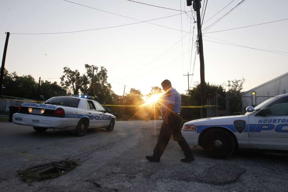 Police investigate a homicide on Duff Street near Irvington Boulevard. Photo: Cody Duty, Houston Chronicle