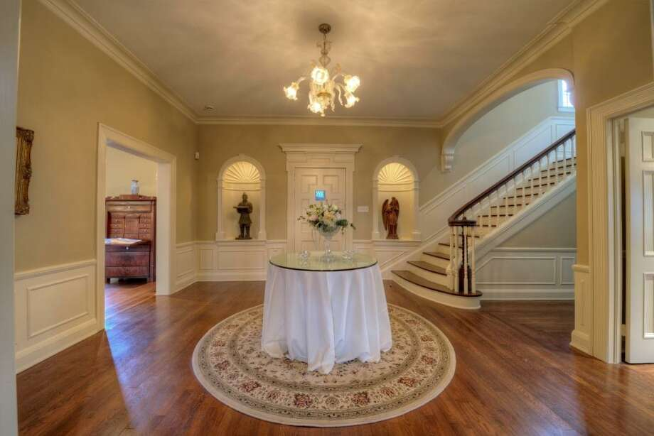 Upon entering the home, you immediately are taken back into time. Complementing the large reception hall, 16' x 15', are the Art Deco chandelier, the two matching niche's and the grand staircase.See the listing here.Prominent trial lawyer selling suburban home