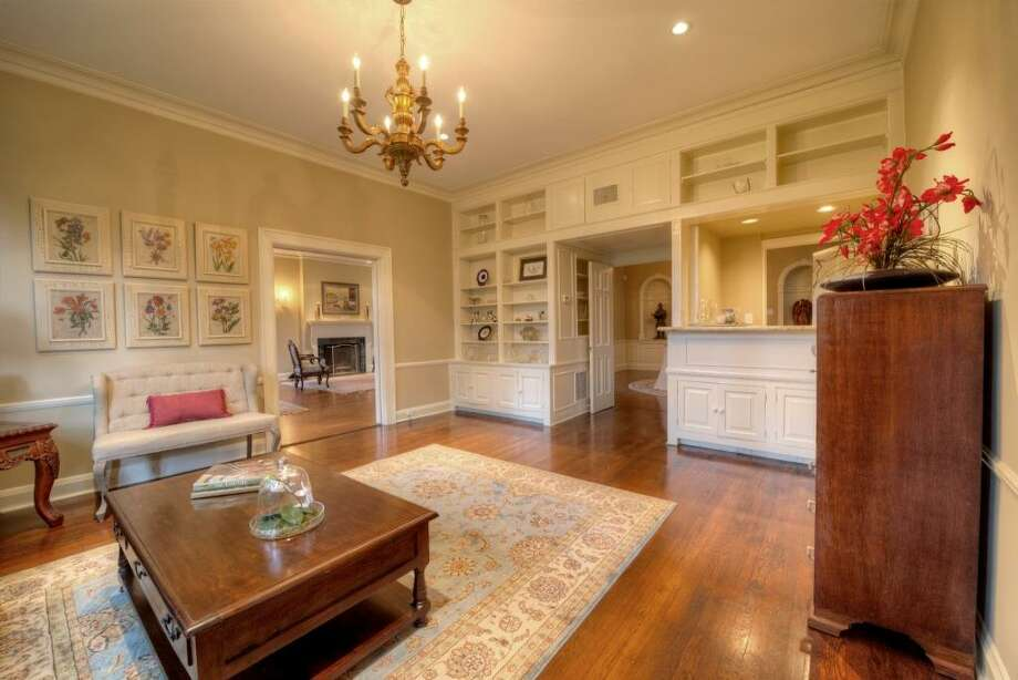 Measuring 21' x 15', the parlor offers the luxury of a wet bar, renovated in 2011, to the right. The pocket doors to the left and the double doors in the center of the frame, provide the option of closing off the room.See the listing here.Prominent trial lawyer selling suburban home