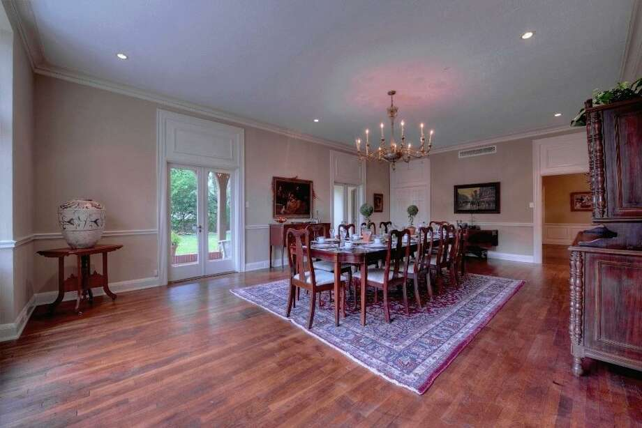 This massive dining room, 28' x 17', is of a large scale rarely seen even in today's most grandest of homes. It could easily allow you to entertain dinner for 20. It is presumed, that the elegant amber Murano chandelier is original to the home.See the listing here.