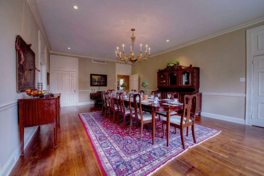From this perspective, take note of the enchanting set of east-facing windows. Focal lighting was installed in 2005 to accentuate the art collection. The red oak floors are original to the home.See the listing here.