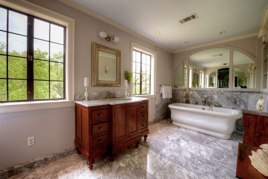 In 2005, the current owners hired a renowned historic preservationist to design the master bath in keeping with its historical roots while enveloping modern-day needs. The Waterworks Empire-style freestanding tub is a marvel that must be seen.See the listing here.