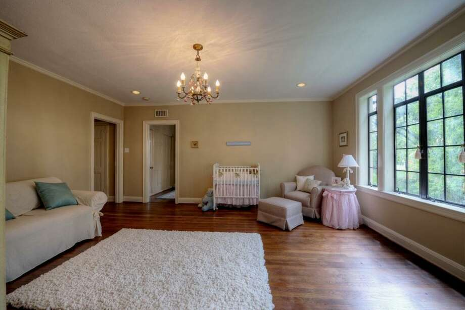 The rose porcelain chandelier is the perfect touch for this warm and inviting room. Again, recessed can lighting, crown molding and hardwood floors are features of this room.See the listing here.