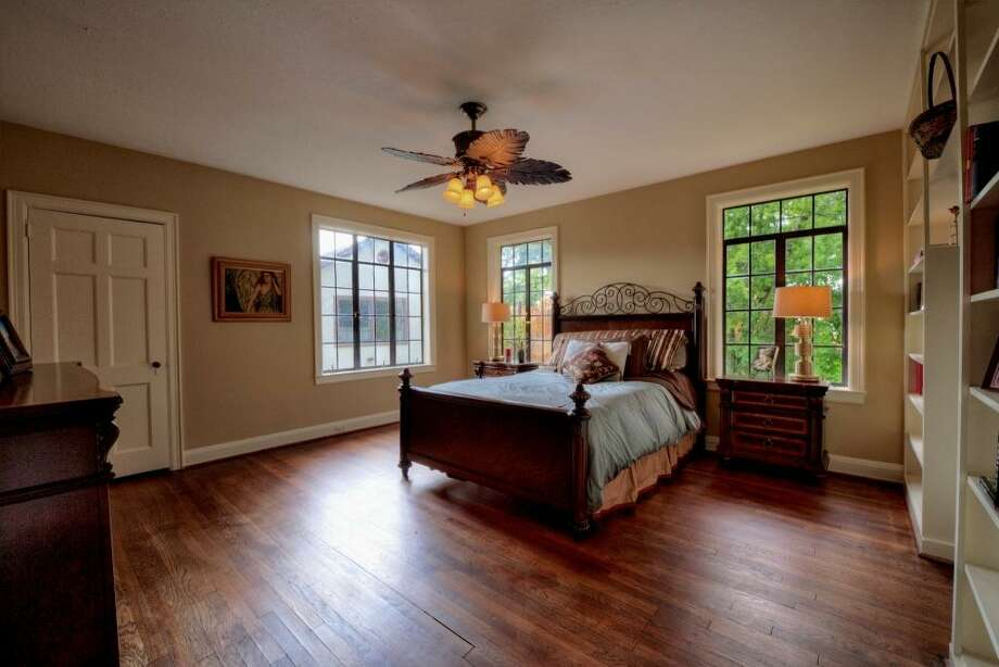 This southeast bedroom measures 16' x 15' and has extraordinary functionality with a wall of built-ins. This room and the nursery are separated by a large bathroom that was renovated in 2013, dressing area and closet.See the listing here.