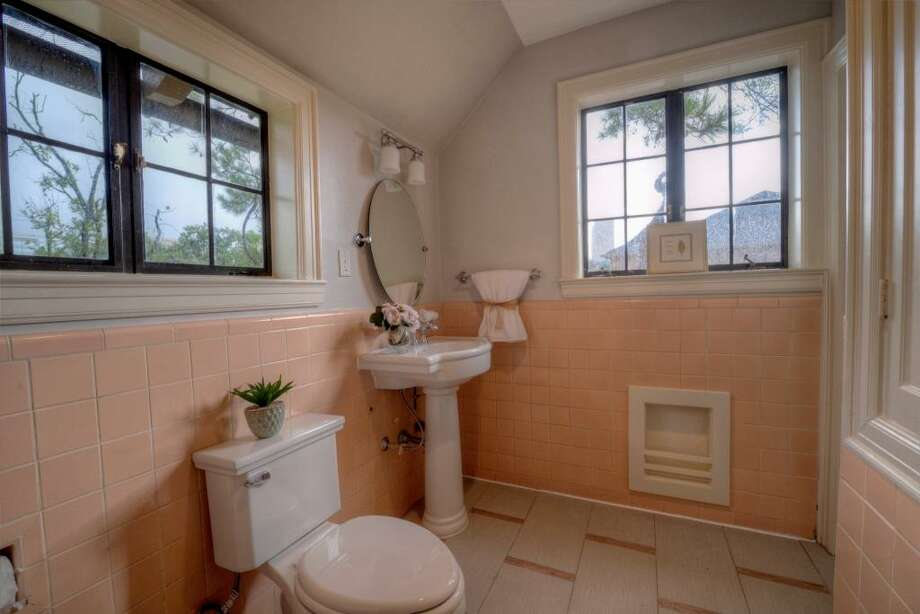 Renovated in 2013, this secondary bathroom mixed the vintage tile with the taste of the 21st century. A new pedestal sink, faucet, commode and accessories were installed, along with a creative magazine rack to the right of the frame.See the listing here.